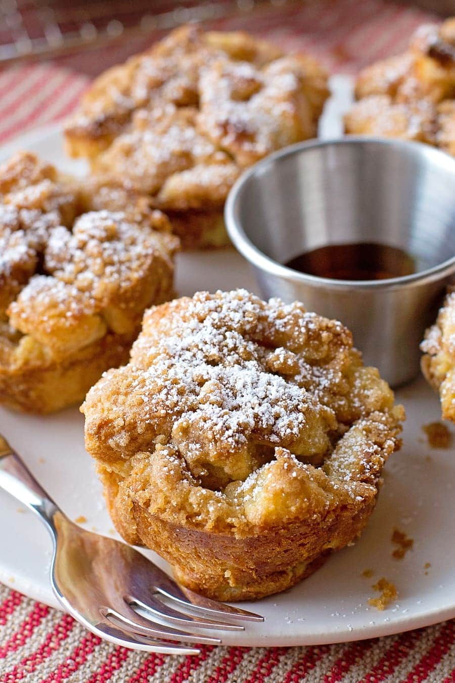 French Toast Muffins - easy to make, using things you already have in your pantry!! Your choice of bread, cubed and covered in egg and vanilla mixture, topped with a delicious sugary topping, and baked until golden and crispy. DELICIOUS!!