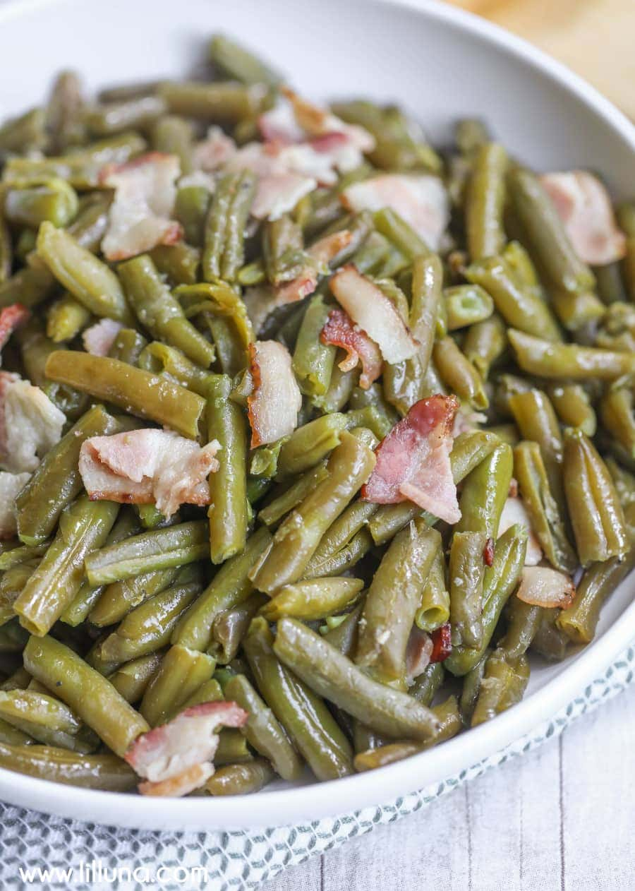 Crock Pot Green Beans - just a few ingredients make the yummiest green beans ever! We love this delicious side dish recipe.