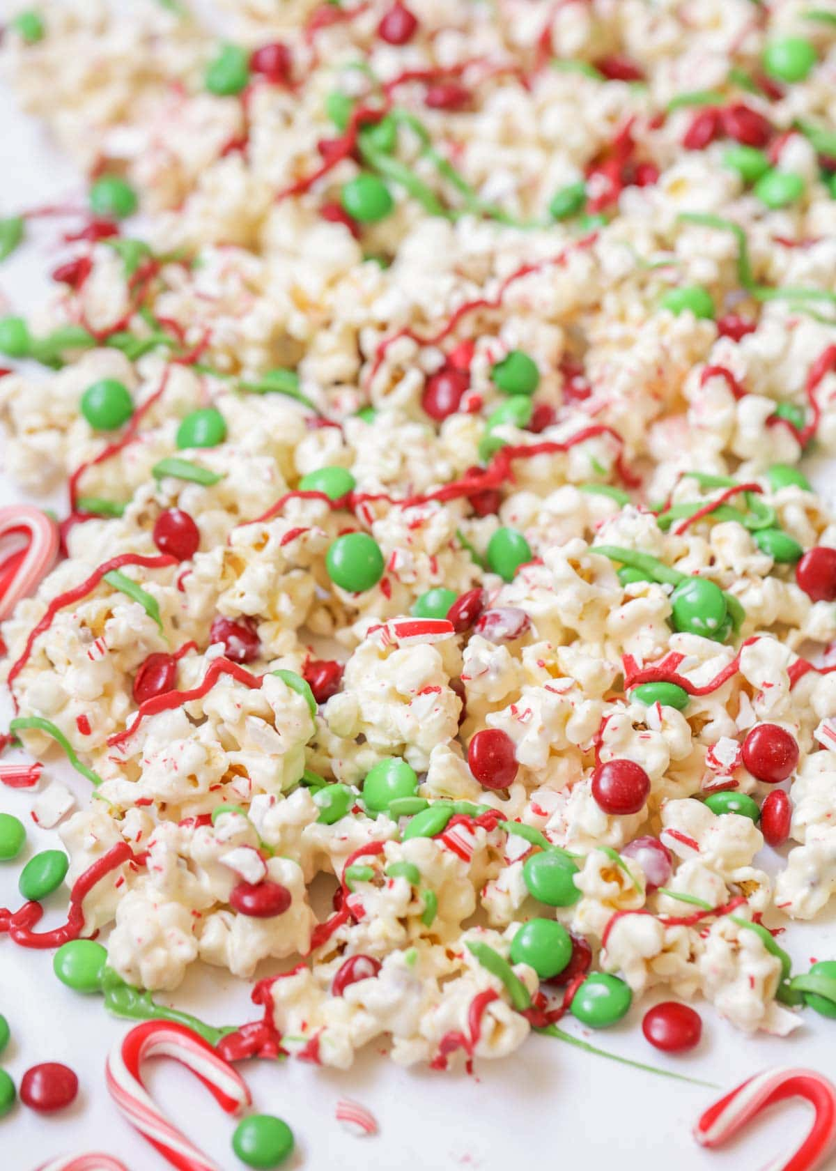 A spread of candy coated Christmas popcorn