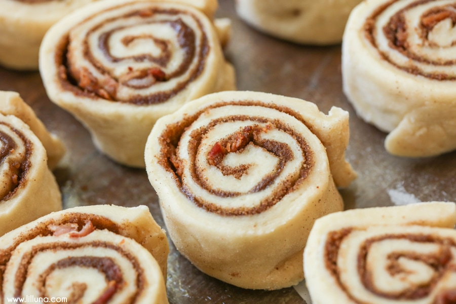 Maple Bacon Cinnamon Rolls - With a maple bacon glaze and bacon chunks throughout, these are sure to be a hit!