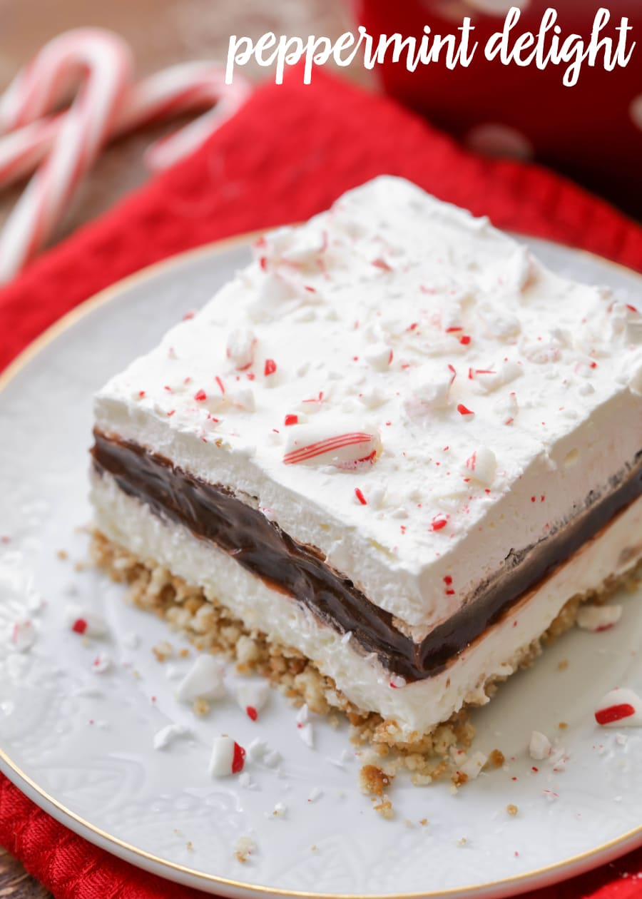 Peppermint Chocolate Delight - Nilla wafer crust, cream cheese layer, chocolate pudding layer, whipped cream and candy cane pieces. It's our new favorite Christmas dessert!