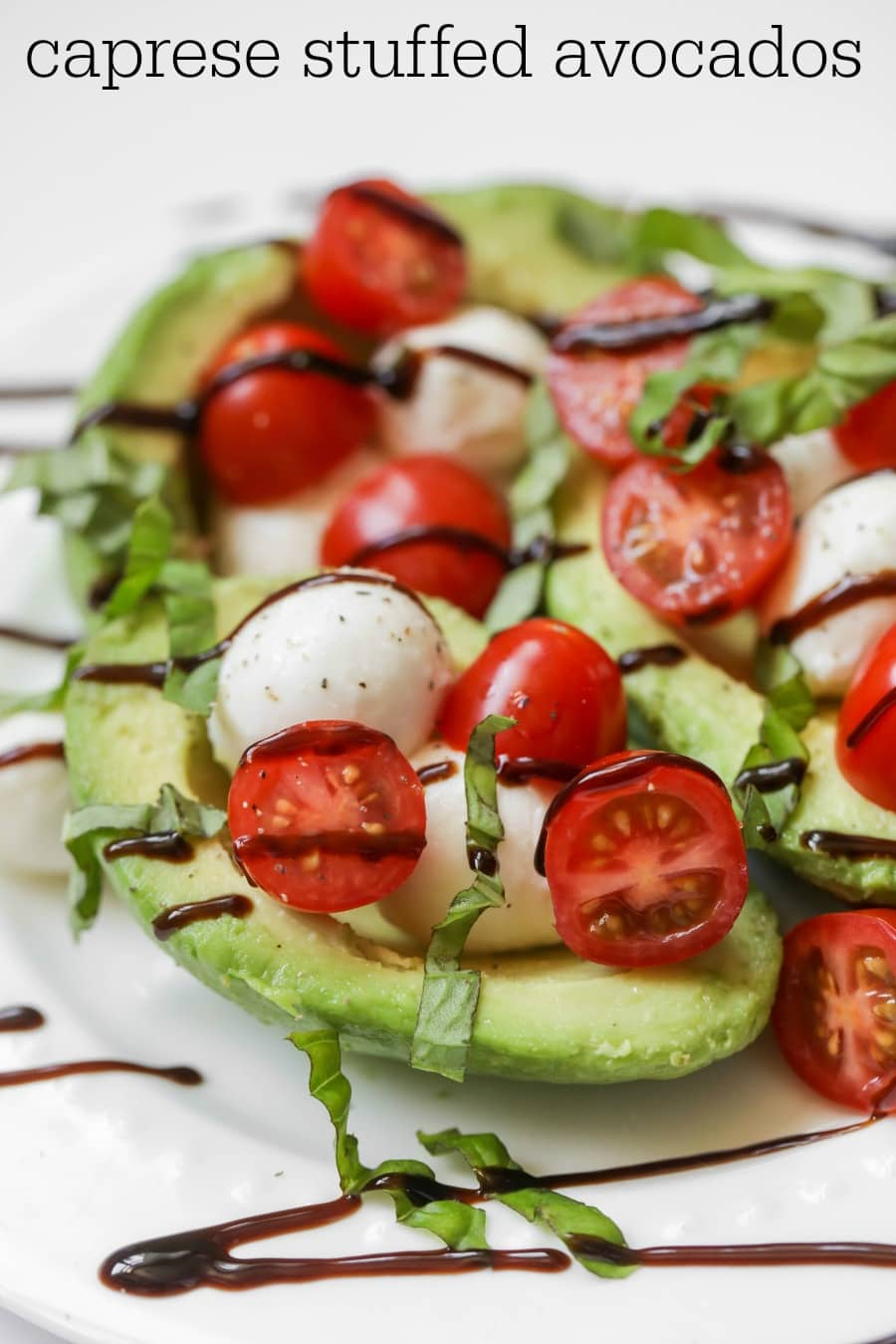Caprese Stuffed Avocados - filled with Mozzarella, tomatoes, basil and balsamic glaze providing a great side/salad to any meal.