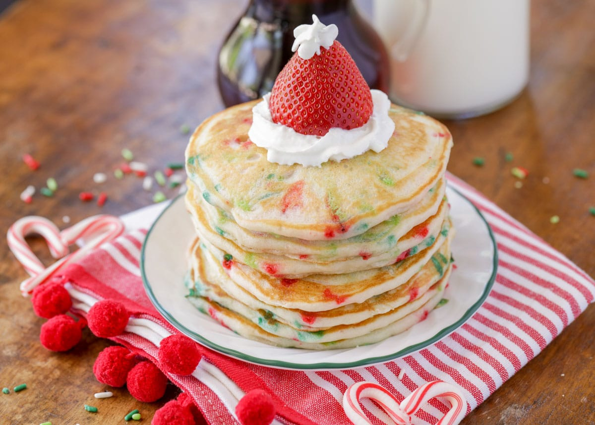 Christmas pancakes with red and green sprinkles with Santa hat strawberry