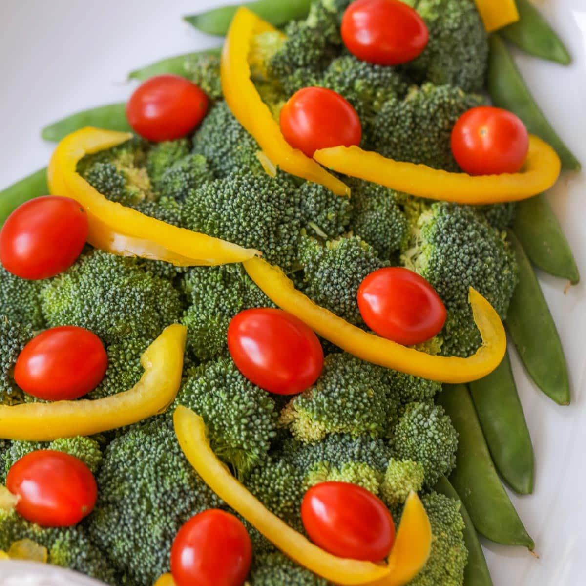 Assembled Christmas tree veggie platter on a white plate