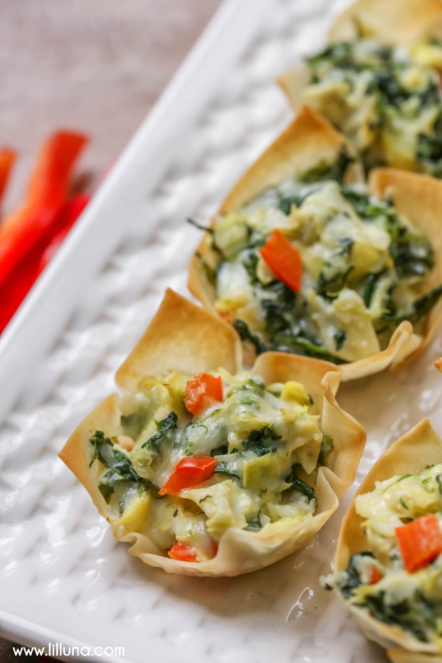 Cheesy Spinach and Artichoke Cups - this easy appetizer is full of flavor and perfect as an appetizer or side dish.