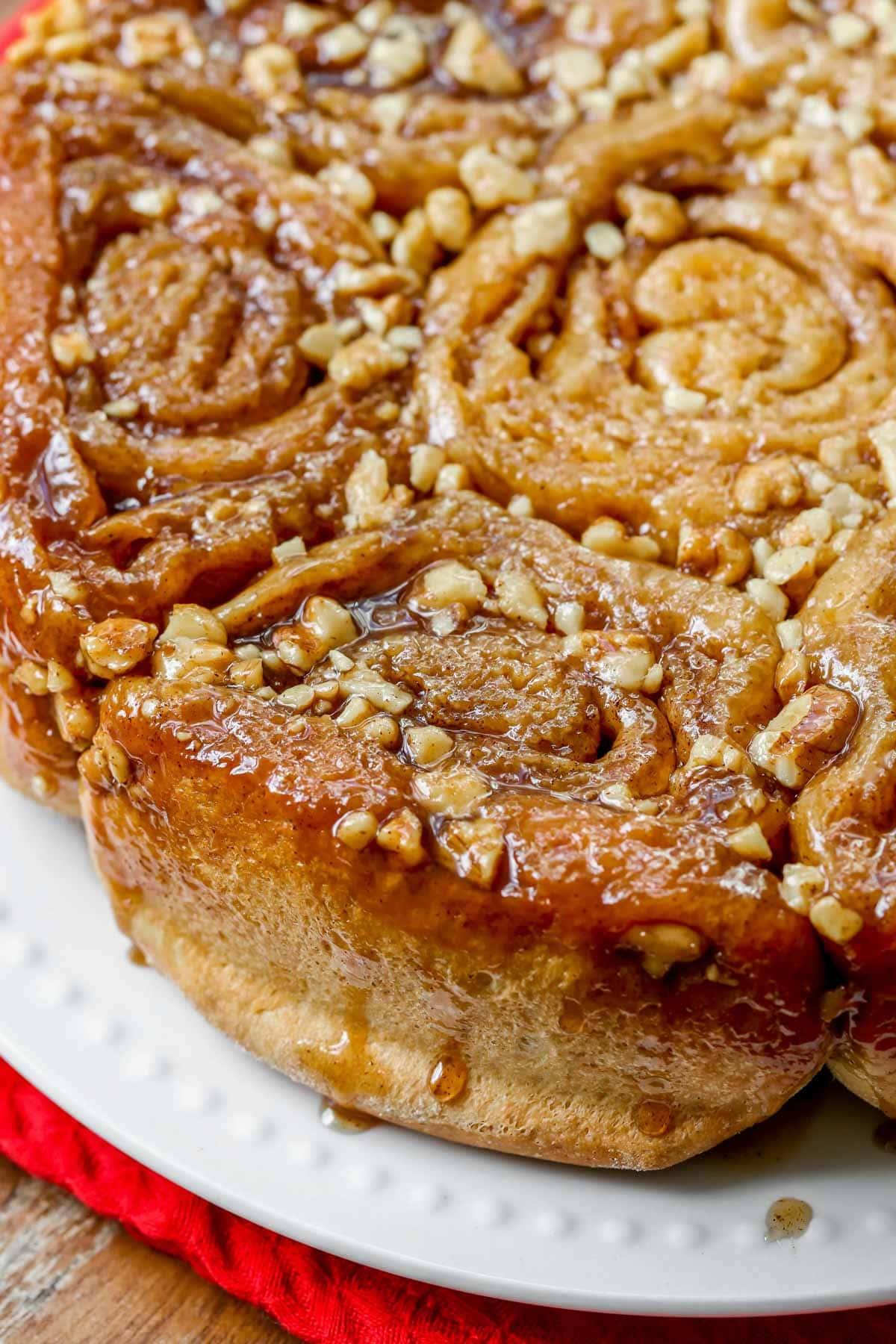 Sticky walnut buns served on a white plate