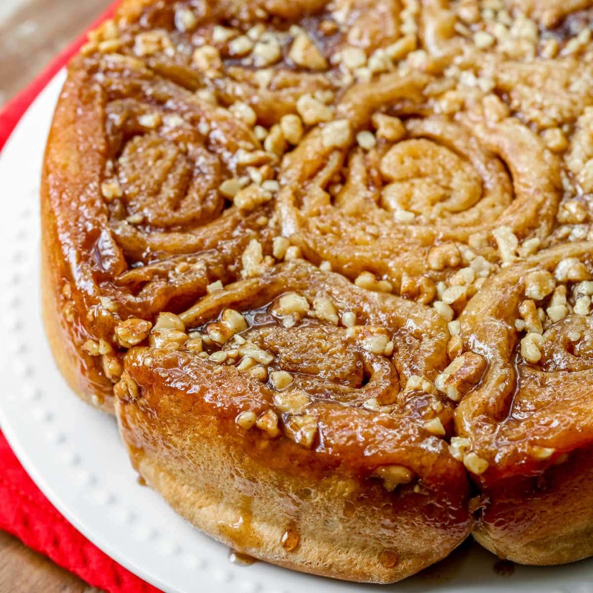 Sticky walnut buns on a white plate