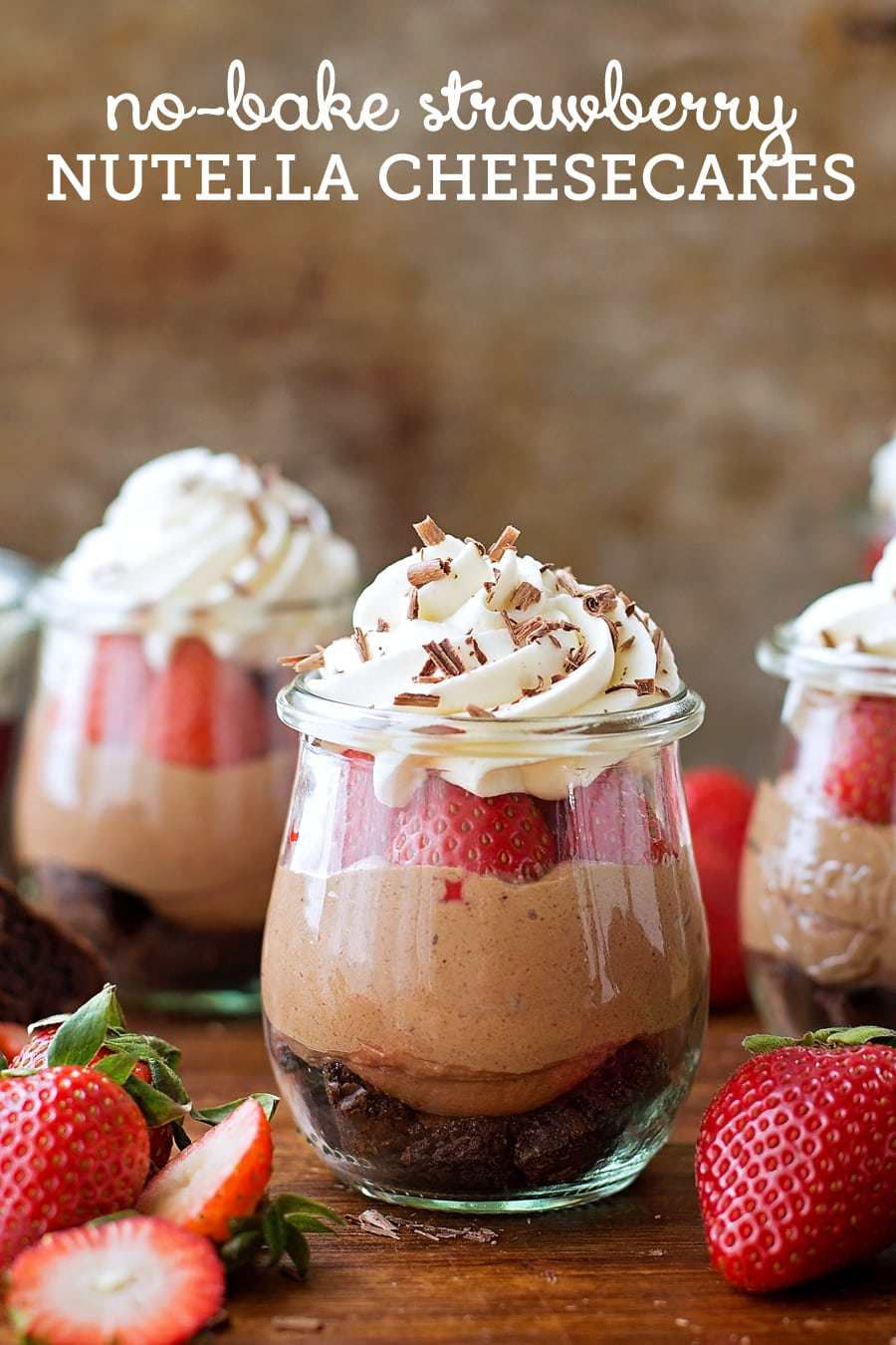 No-Bake Strawberry Nutella Cheesecakes - Brownie, Nutella cheesecake filling, fresh strawberries, and whipped cream all layered together for a delicious chocolatey dessert!!