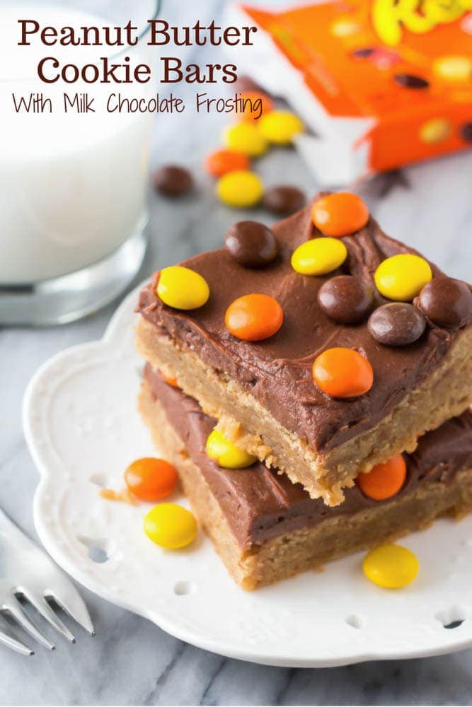 These Peanut Butter Cookie Bars with Chocolate Frosting start with a layer of super soft & chewy peanut butter cookie, then are topped with creamy milk chocolate frosting. So easy & perfect for peanut butter lovers!