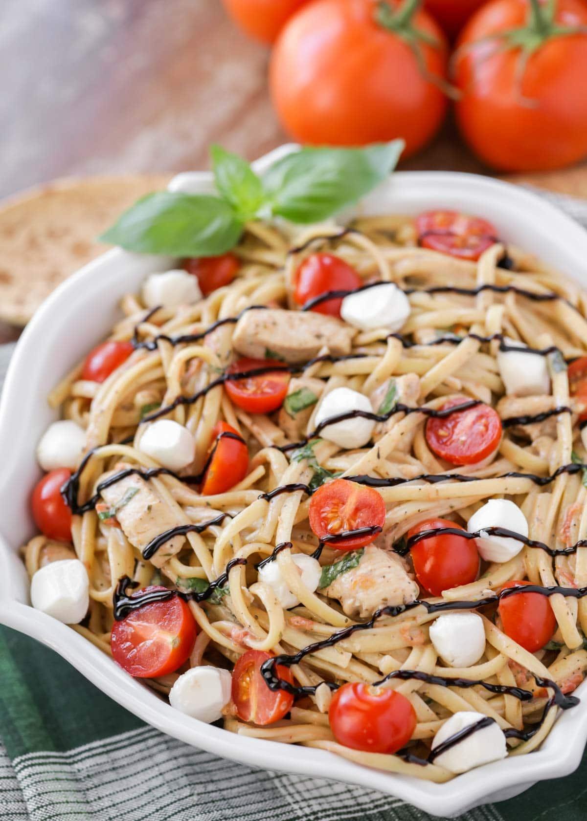 Bruschetta Chicken Pasta recipe drizzled with balsamic glaze