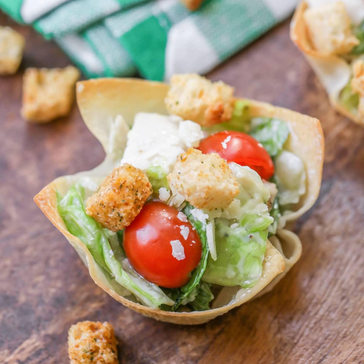 Caesar salad cups inside wontons