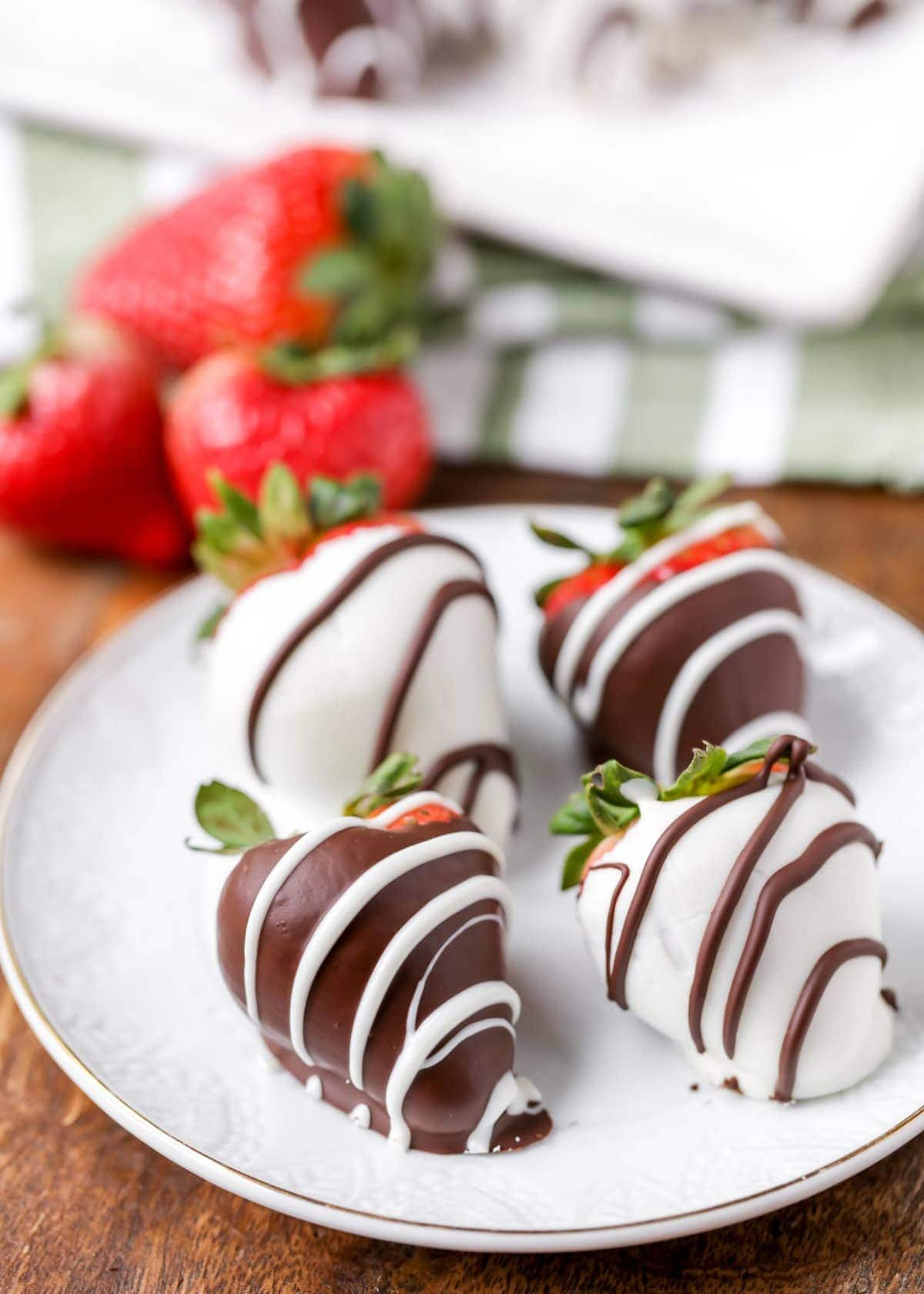 chocolate covered strawberries on white plate