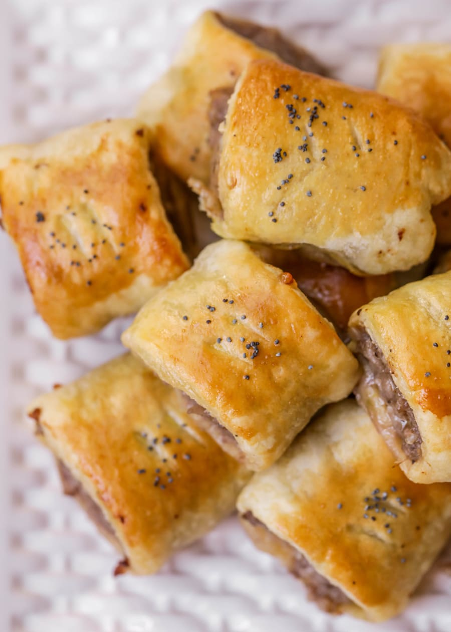 Puff Pastry Rolls - Sausage mixed with delicious seasonings like basil, oregano, and thyme, all wrapped up in a butter puff pastry! These rolls are exploding with flavor!!