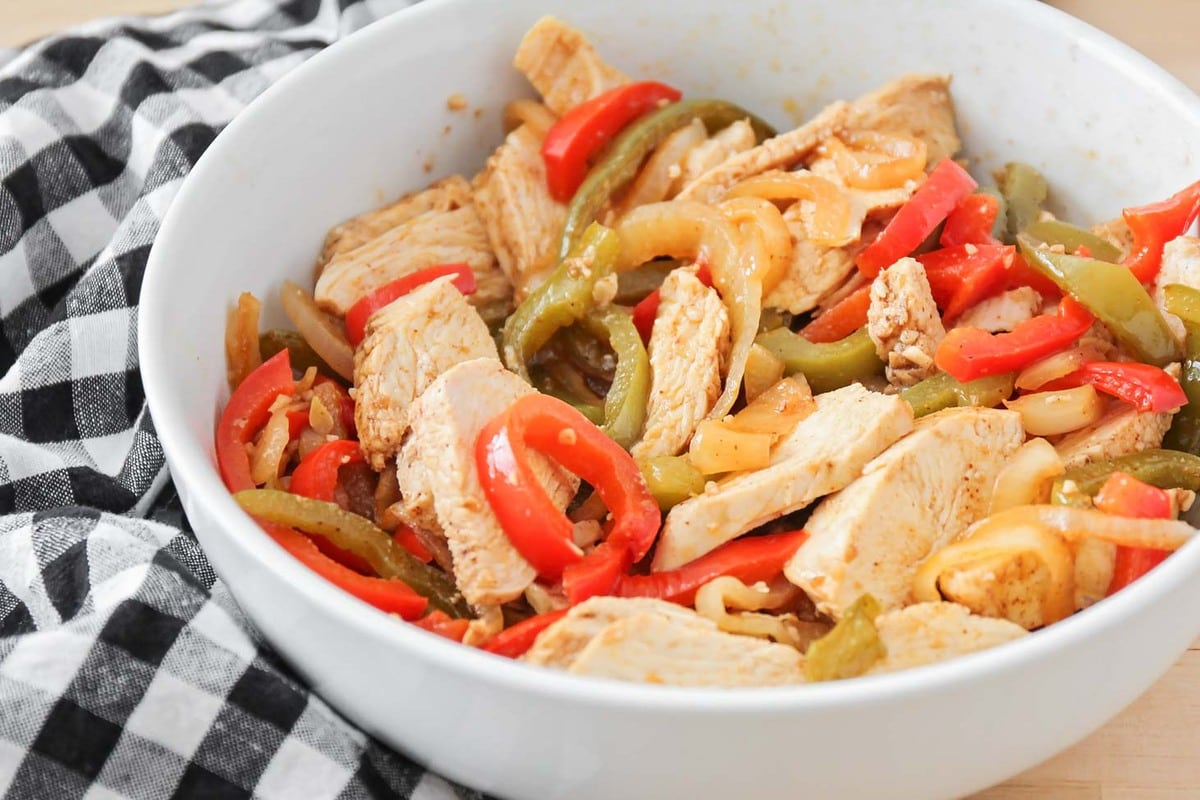 Chicken fajita chicken and vegetable slices in a bowl