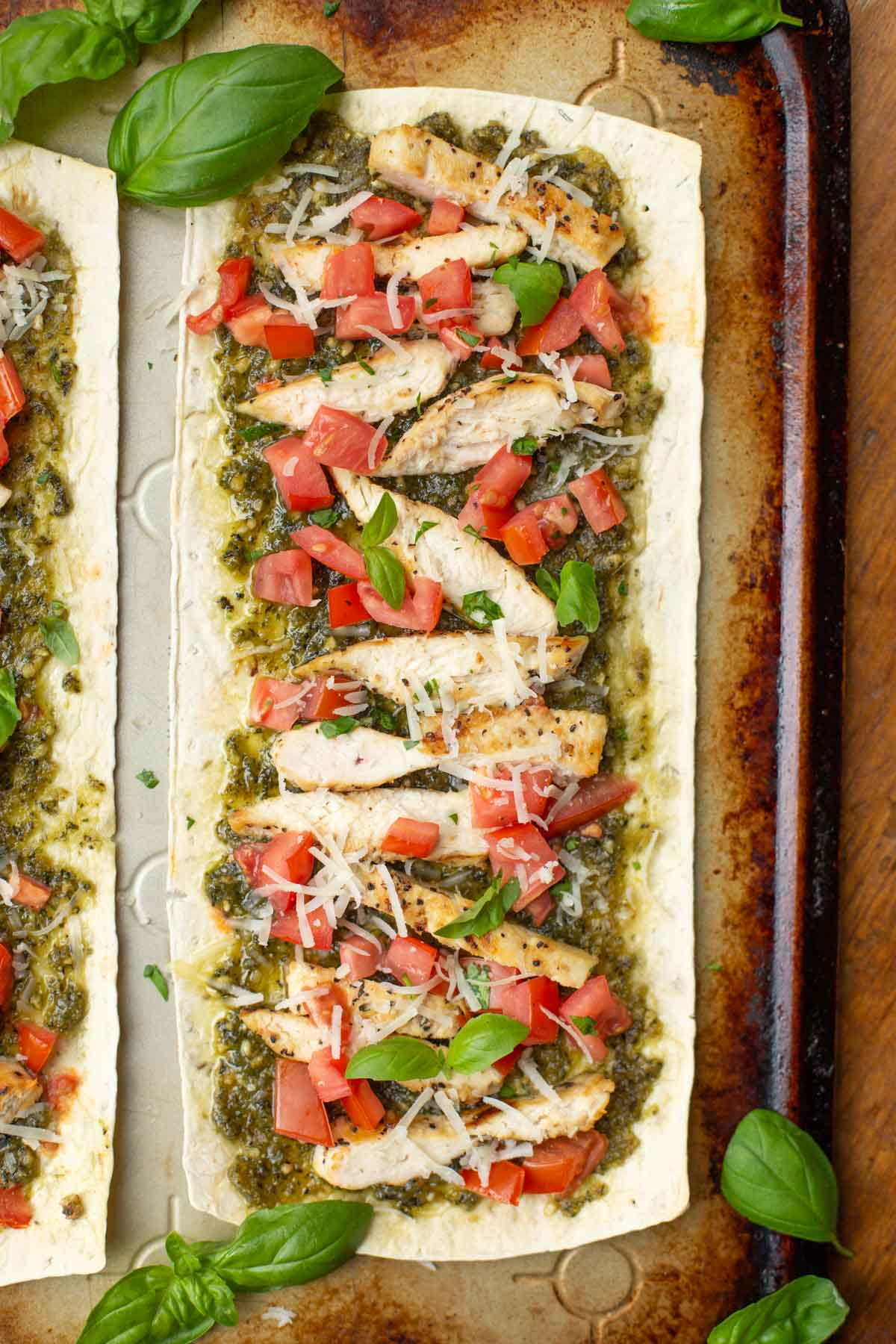 Flatout flatbread pizza with pesto chicken and fresh tomatoes