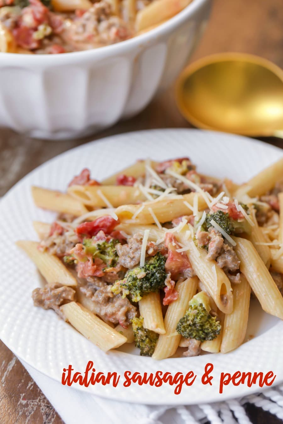 Italian Sausage and Penne - a delicious and flavorful pasta dish filled with broccoli, tomatoes, sausage, cheese and more making it a new favorite dinner recipe!