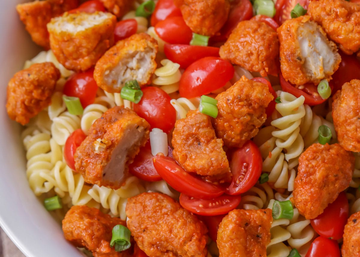 Undressed buffalo pasta salad in a bowl.