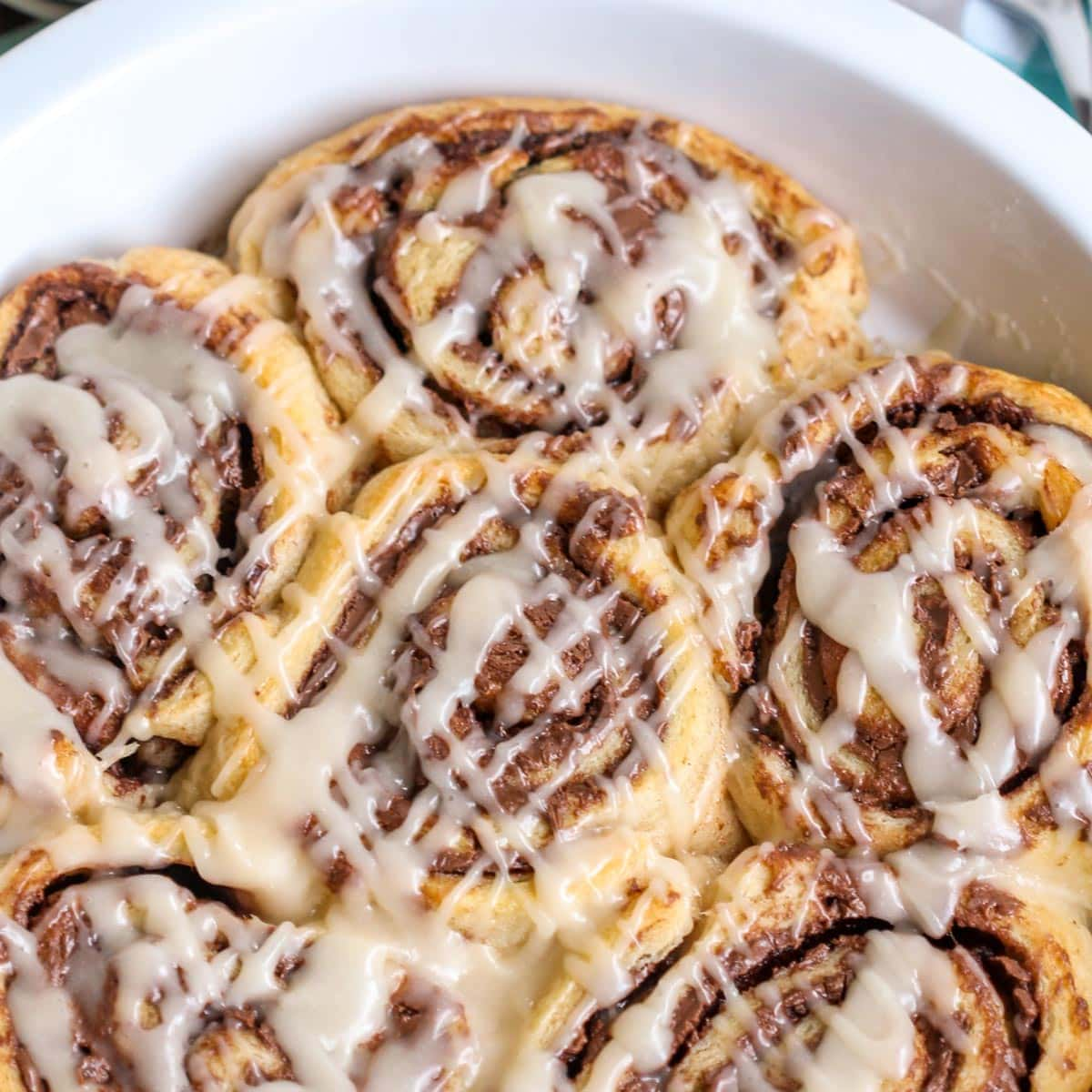 Closeup of nutella cinnamon rolls with glaze on top