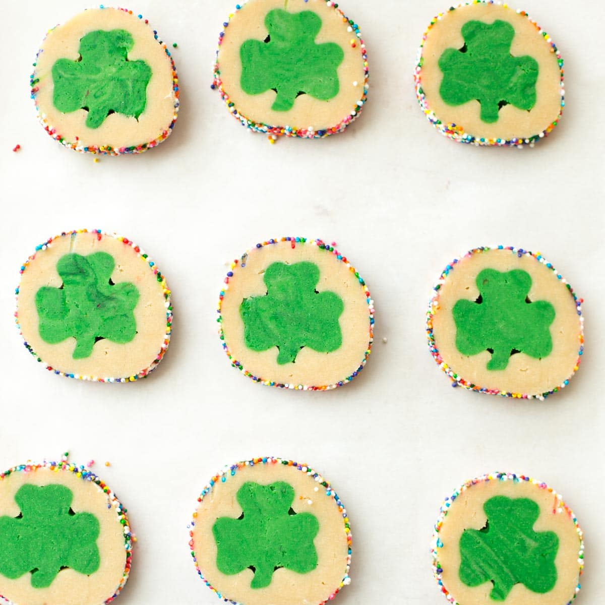 St Patricks day cookie dough slices on a baking sheet