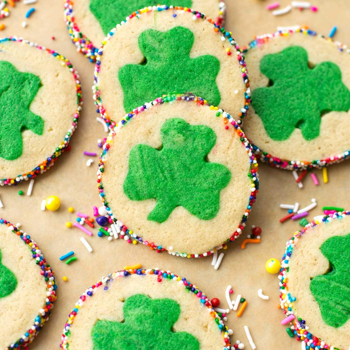 St. Patrick's Day Cookies with a clover in the middle and sprinkles on the edges