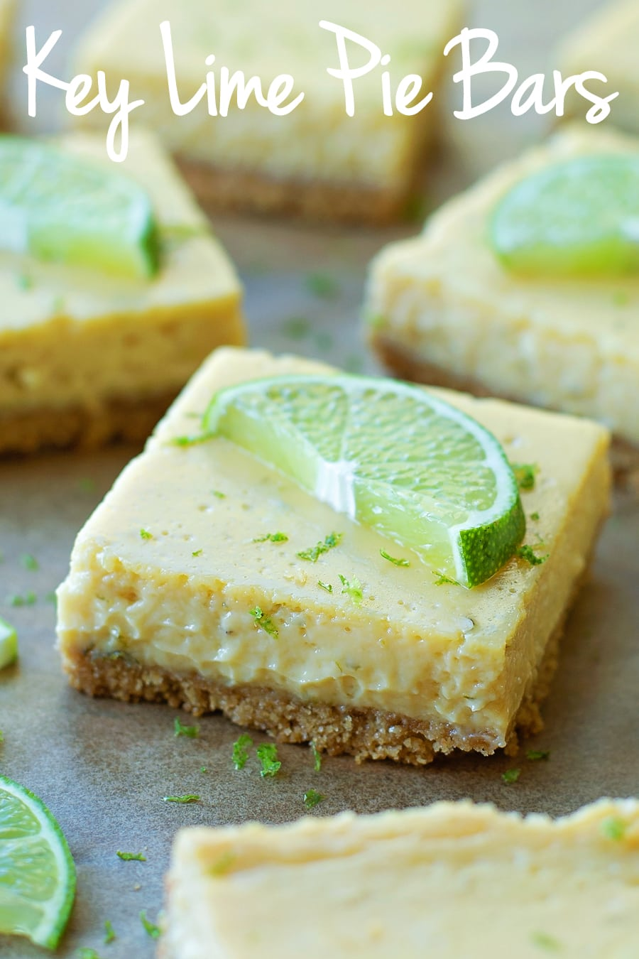 Key Lime Pie Bar squares topped with lime slices