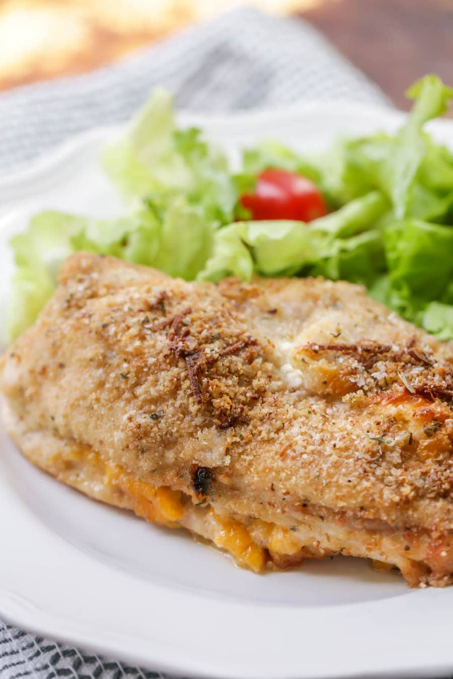 Garlic Lemon Double Stuffed Chicken - Crunchy on the outside and tender and creamy on the inside. Each breast is stuffed with cheddar cheese and cream cheese making it so flavorful and cheesy!!