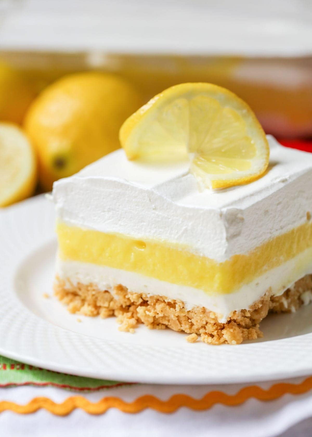 Lemon Lasagna topped with a lemon slice on a white plate