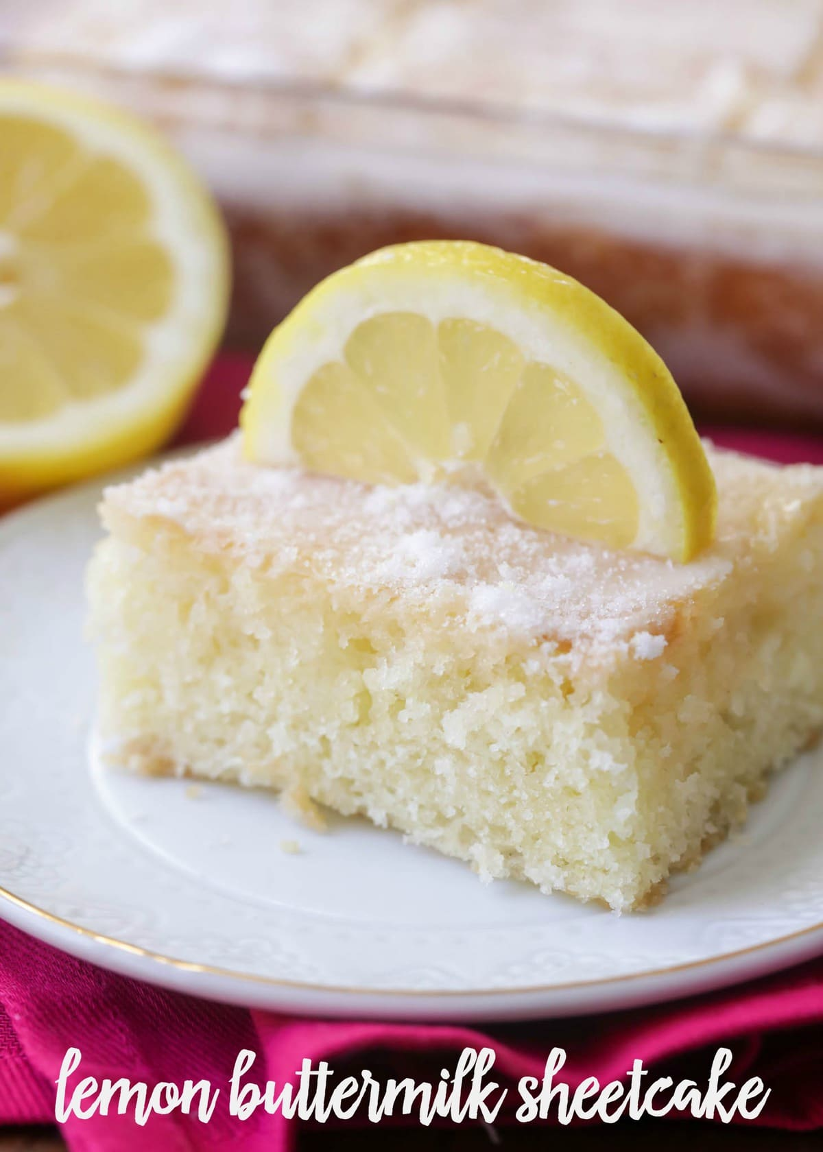 Lemon Cake - Sheet cake baked with a lemon zest, topped with a delicious lemony glaze! The perfect amount of lemon flavor - not too tart, but just enough to give you a delicious lemon taste!