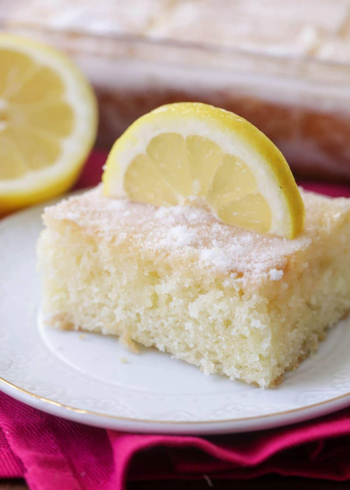 Lemon Buttermilk Sheetcake - Sheetcake baked with a lemon zest, topped with a delicious lemony glaze! The perfect amount of lemon flavor - not too tart, but just enough to give you a delicious lemon taste!