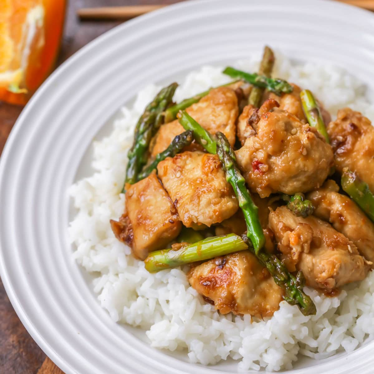 Orange chicken and asparagus served over white rice