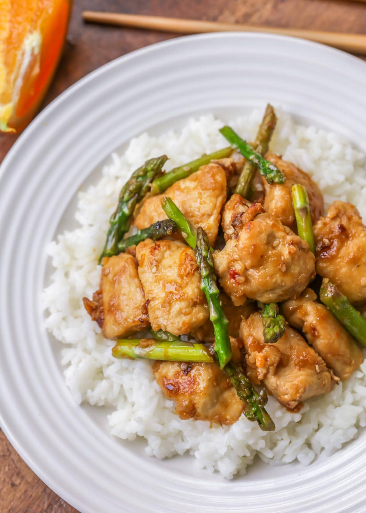 Orange chicken with asparagus served over white rice