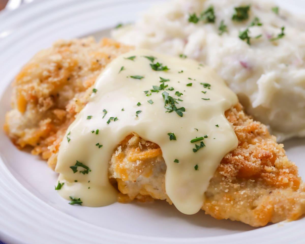 Ritz cracker chicken with sauce on white plate