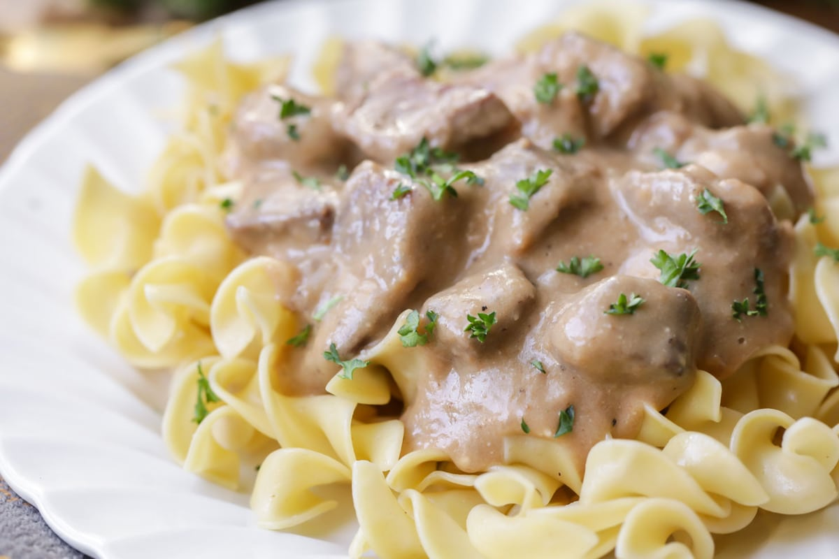 Beef Stroganoff recipe with egg noodles on plate