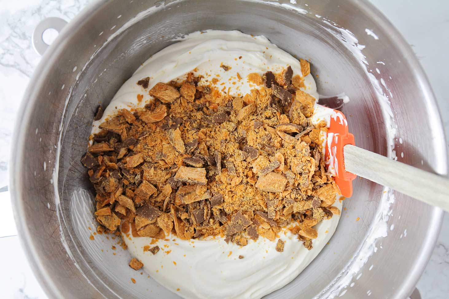 Filling in a mixing bowl for butterfinger pie recipe in