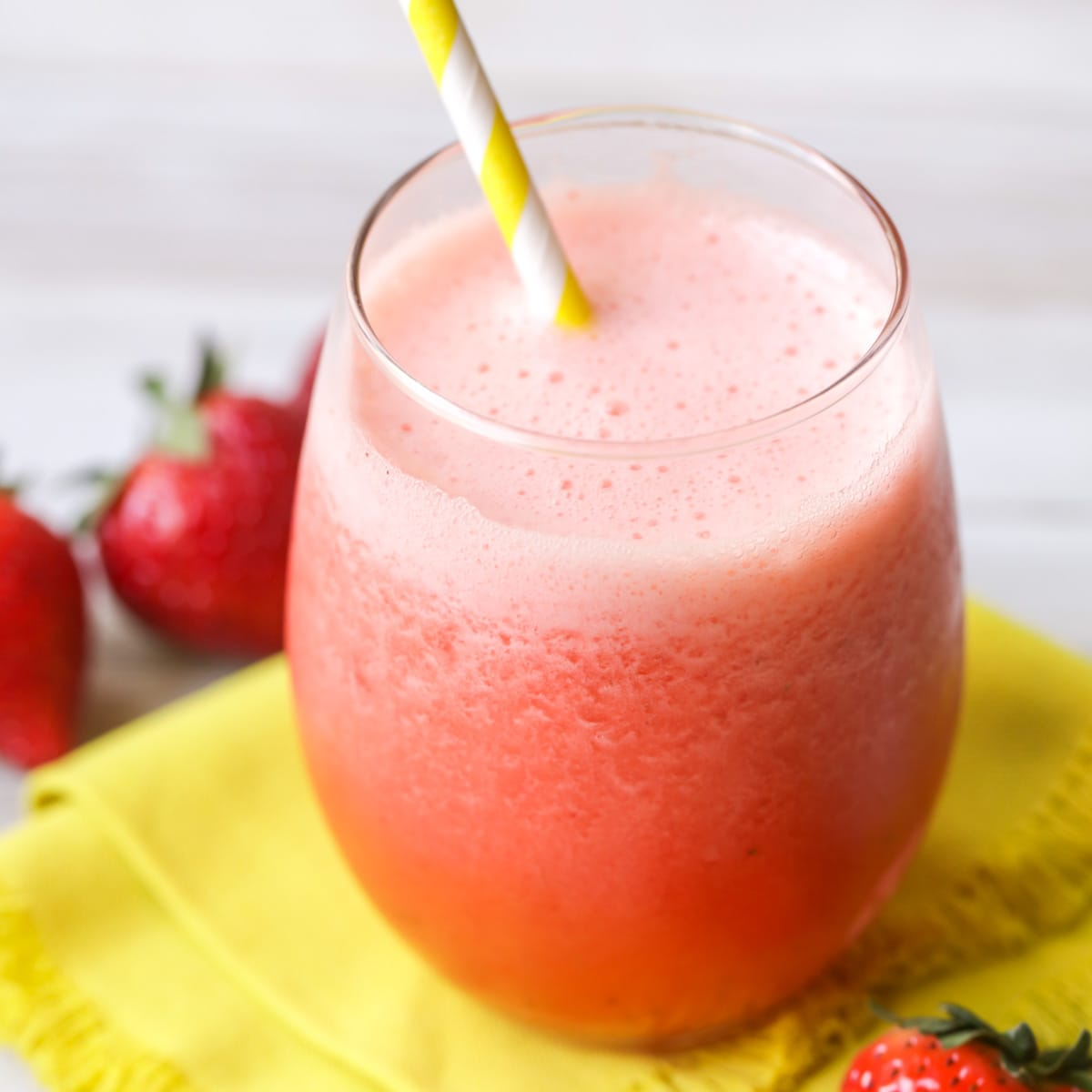 Frozen strawberry lemonade in a glass with a straw
