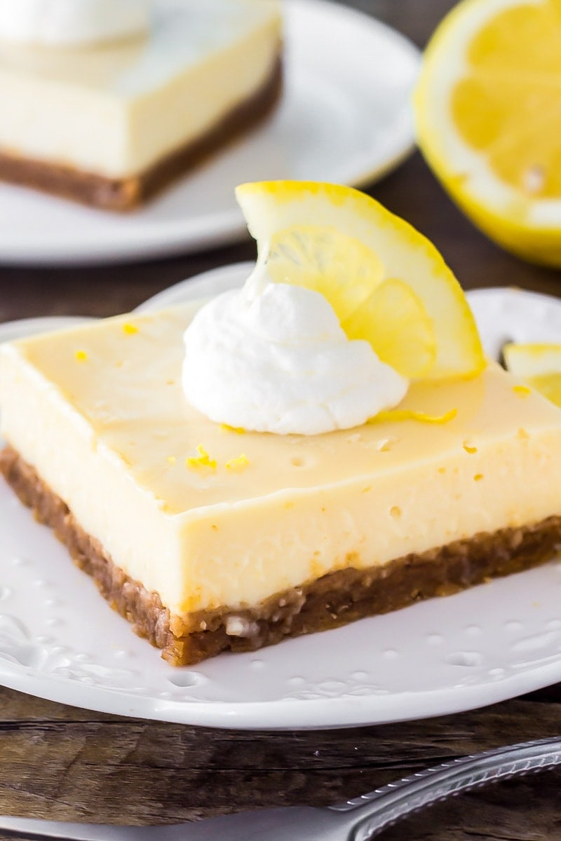 These lemon cream pie bars are smooth and creamy with a bright sunshine-y lemon flavor. With a graham cracker crust - they're way easier than making lemon pie!