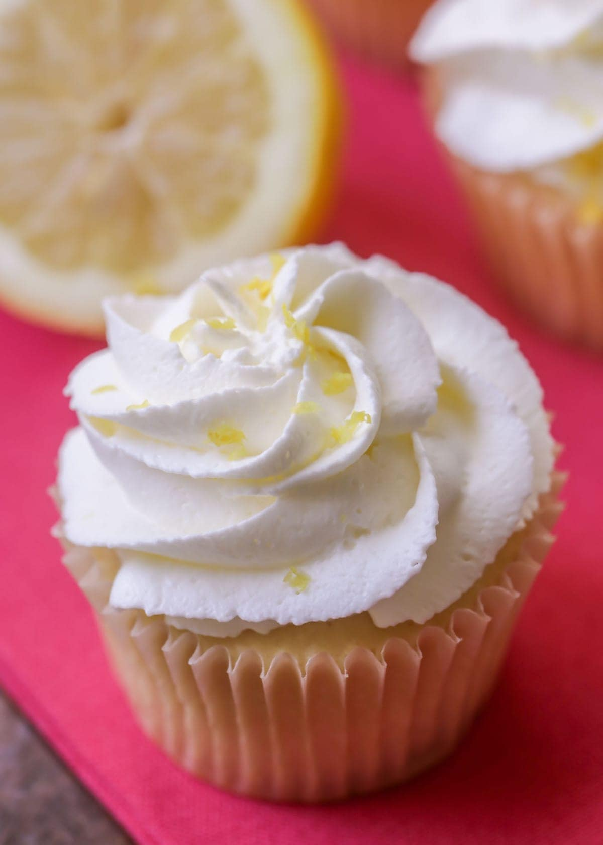 Soft Lemon Cupcakes with a delicious homemade lemon cream frosting. The perfect summer treat!