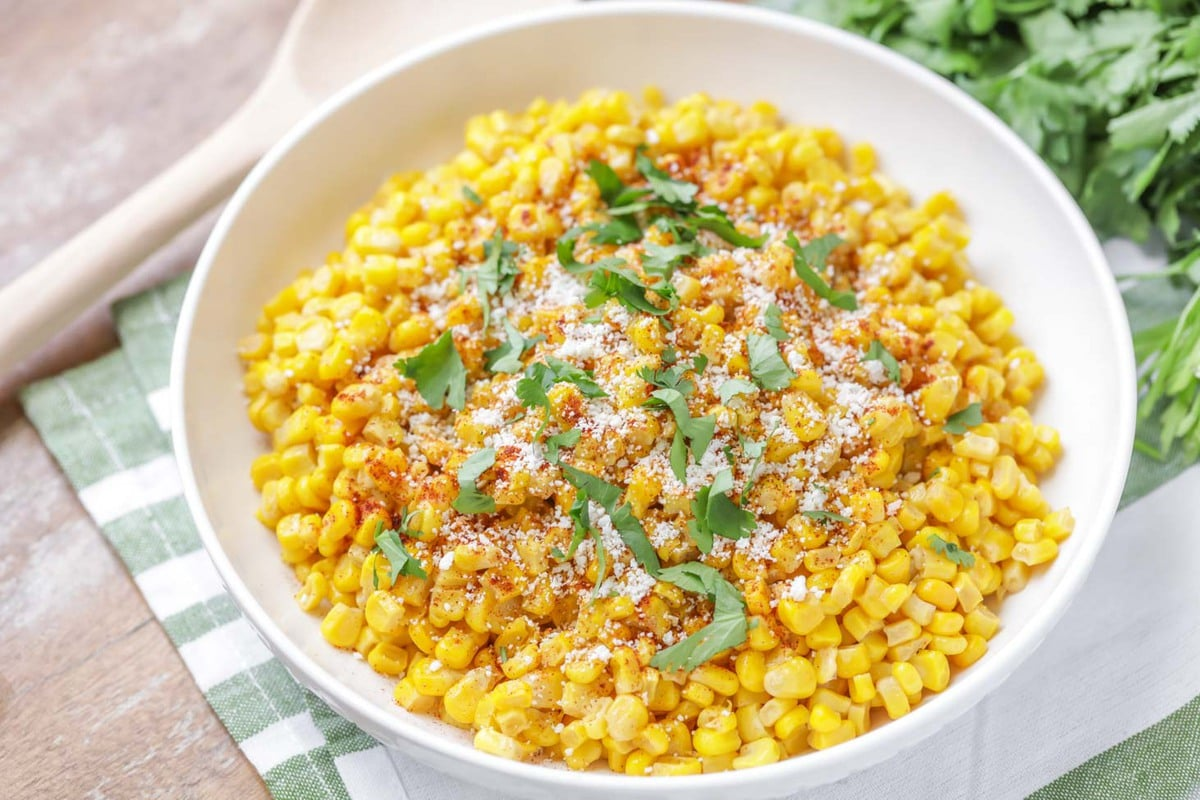 Mexican street corn topped with cilantro and cotija cheese