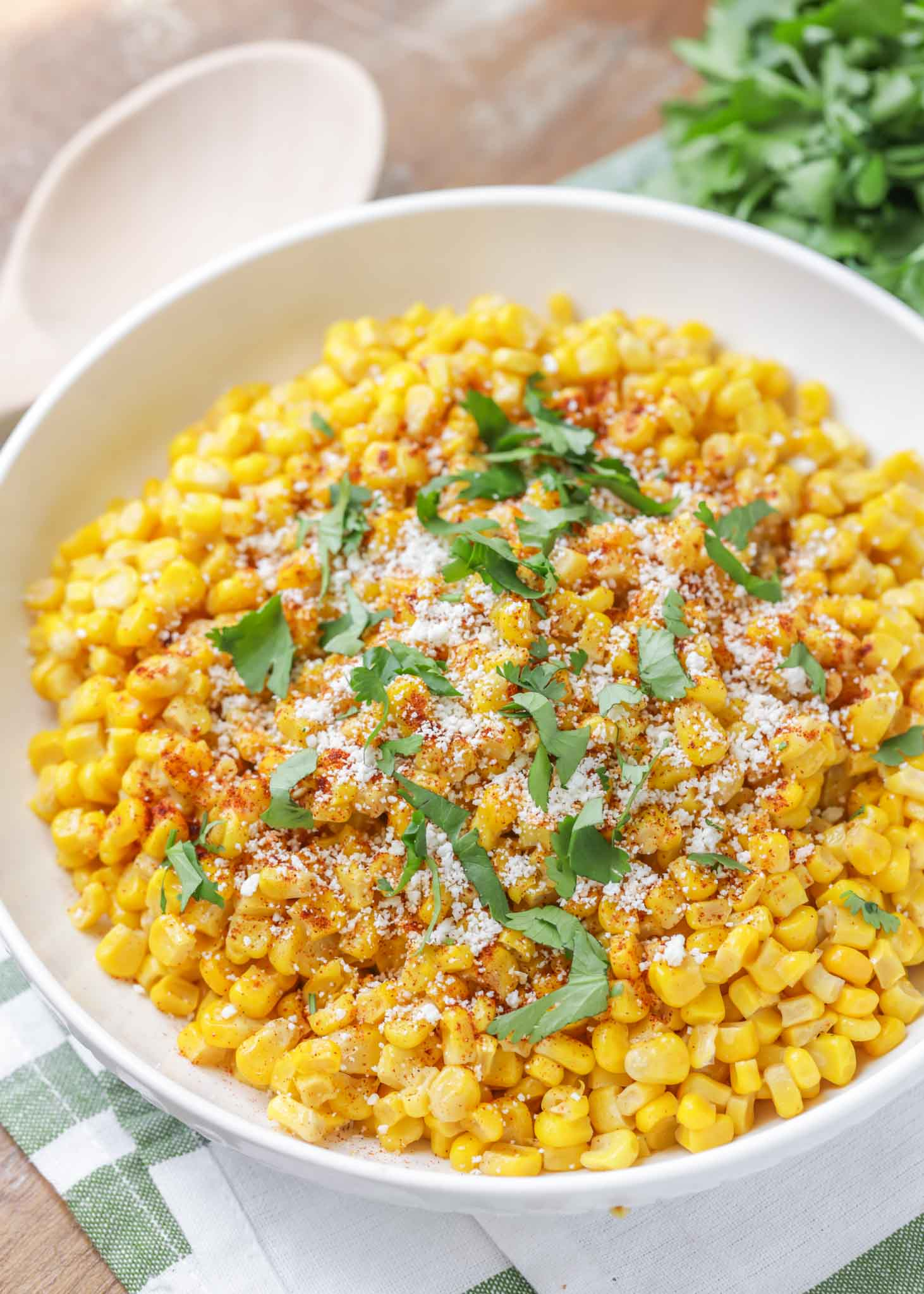 Mexican street corn off the cob in a white bowl