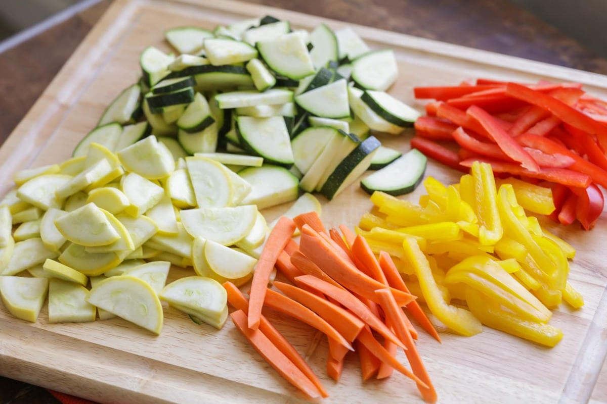 chopped vegetables on a cutting board for pasta primavera recipe