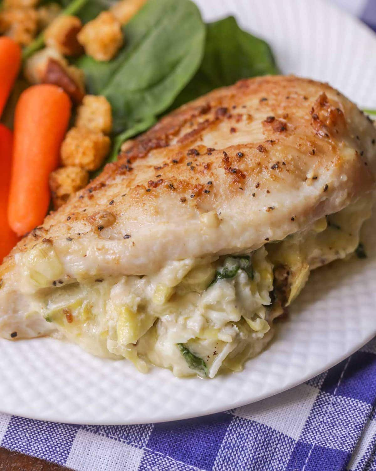 Spinach Artichoke Stuffed Chicken recipe - delicious tender chicken stuffed with a cheesy spinach and artichoke mixture and cooked to perfection!