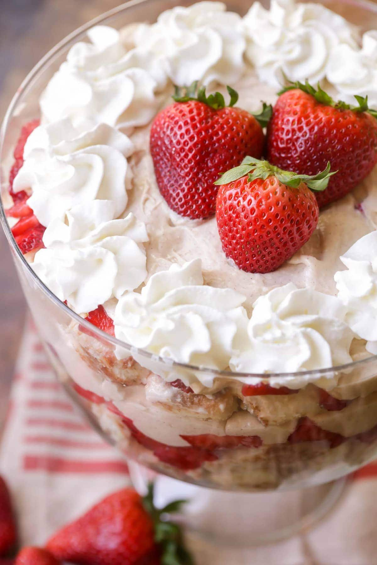 Strawberry Coconut Tres Leches Trifle - a delicious and cool layered dessert with sweetened condensed milk, coconut milk, whipped cream pudding, cinnamon and strawberries.