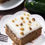This zucchini cake with cream cheese frosting is moist, filled with spices and the perfect way use up zucchini. Topped with fluffy cream cheese frosting.