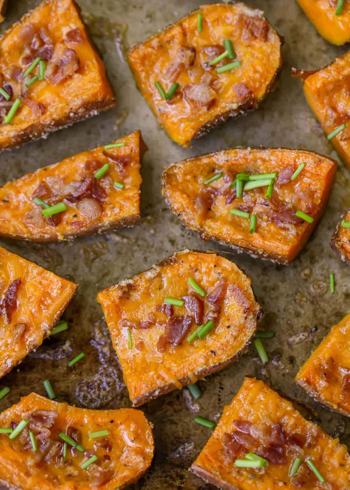 Sweet Potato Skins - a delicious appetizer with a buttery Parmesan crusted glaze and topped with bacon and chives.