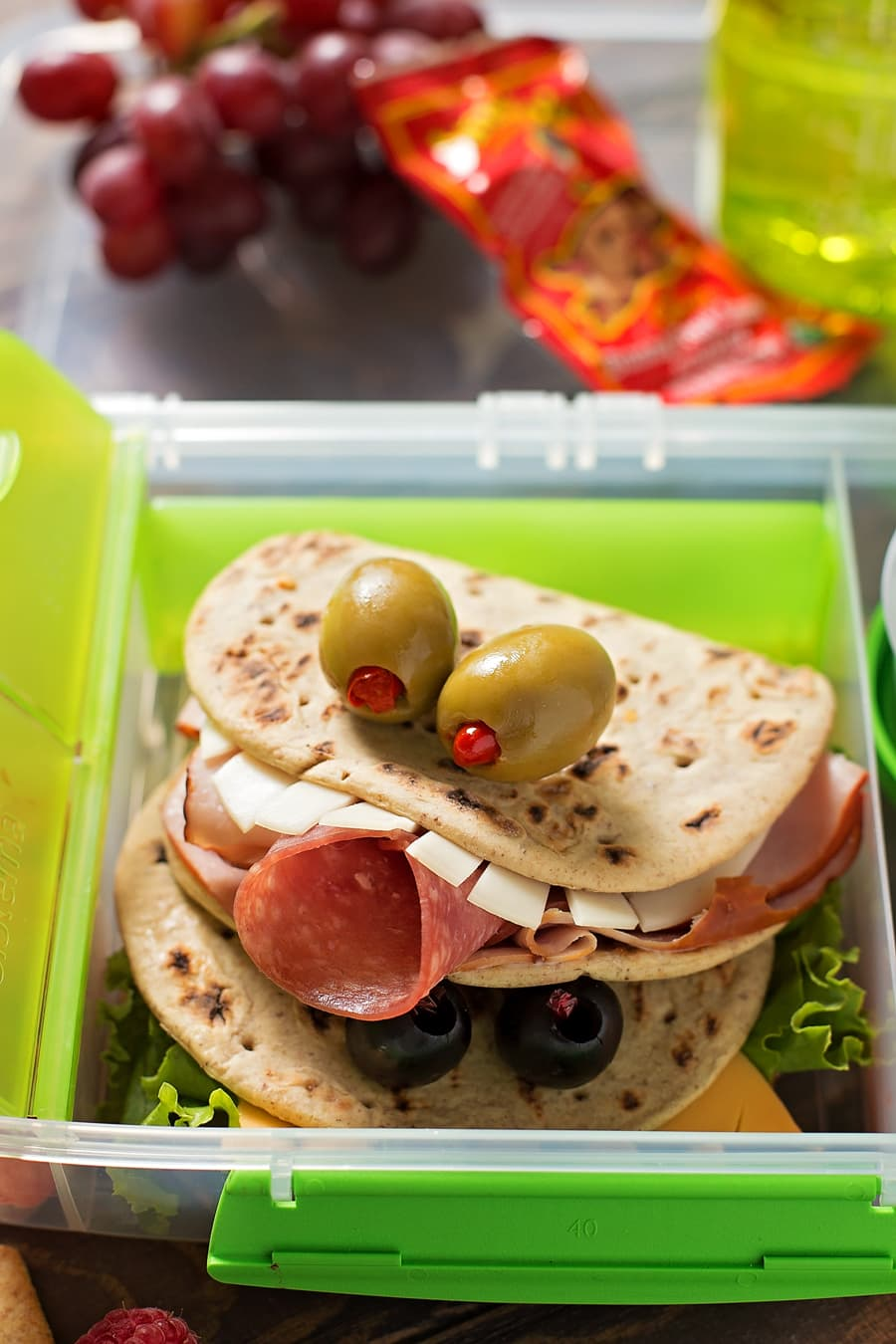 Fun and delicious Flatbread Monster sandwiches! Fill with your favorite meats, cheese and veggies and they're a hit with the entire family.