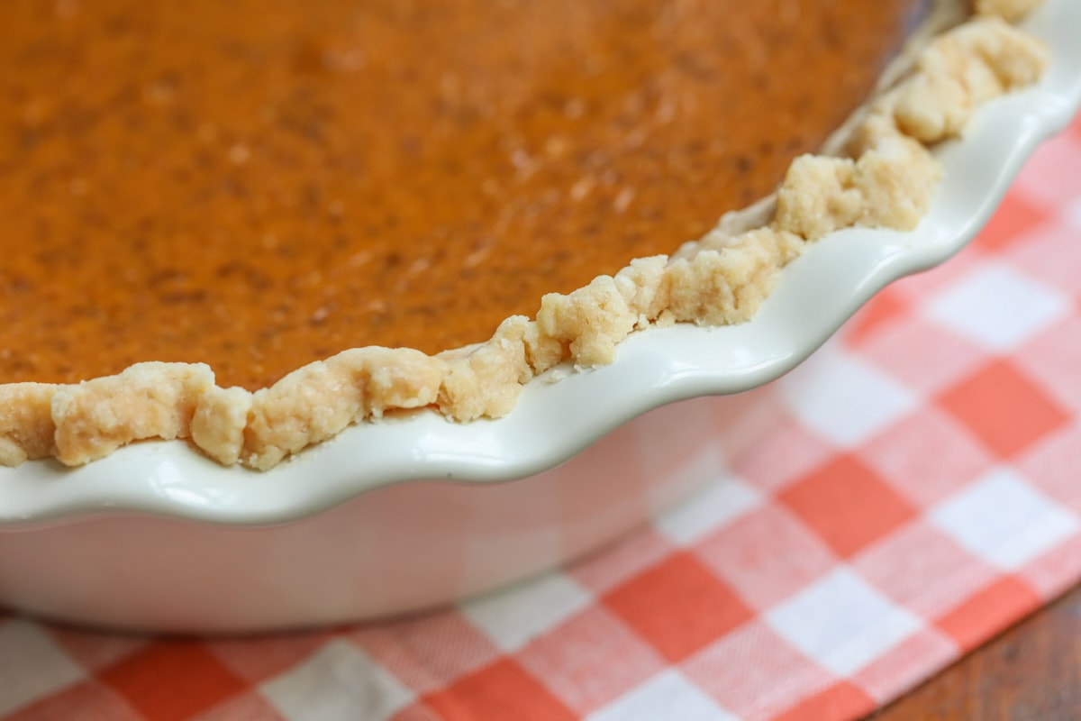 Up close of Pumpkin Pie Crust in a pie dish