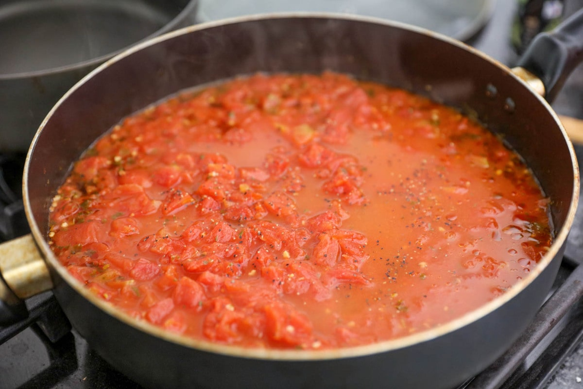 Tomato basil soup ingredients cooking in a pan