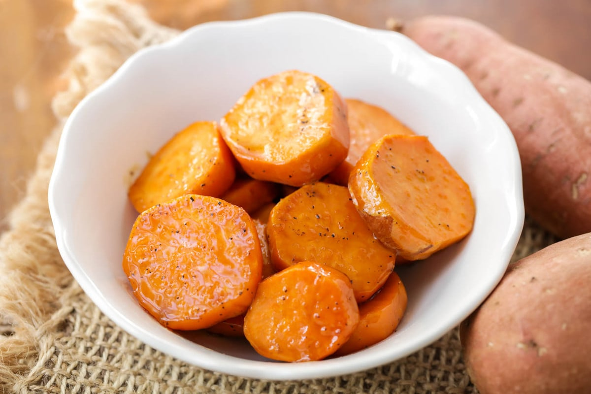 Candied Sweet Potatoes in white bowl