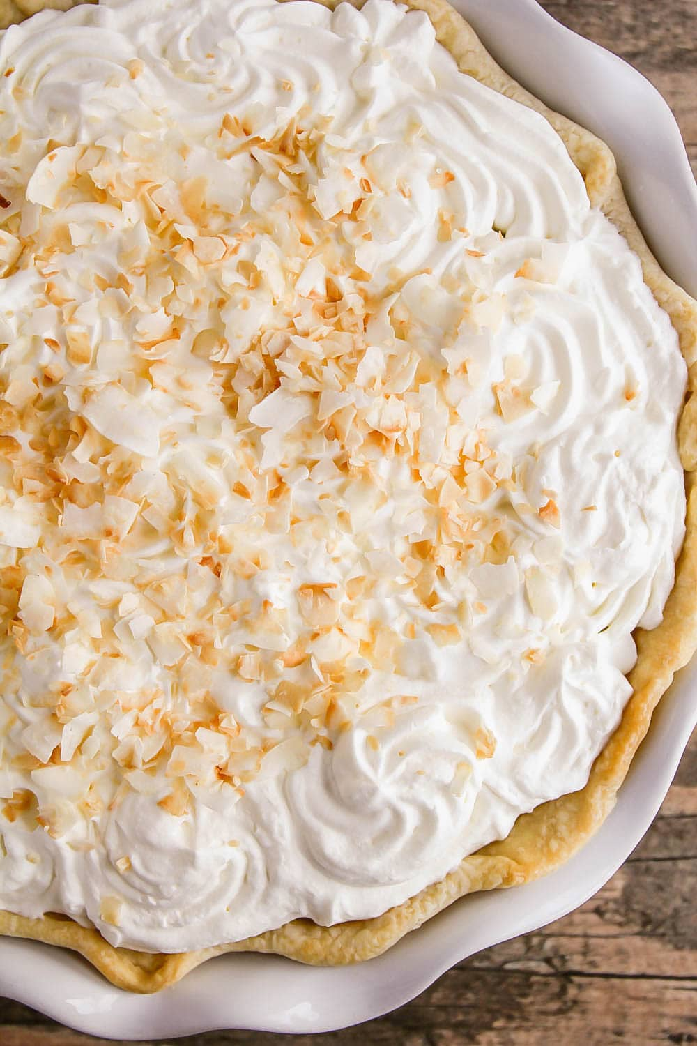 Overhead shot of coconut cream pie topped with coconut