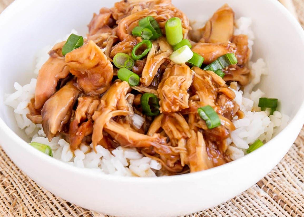 Crock pot teriyaki chicken shredded and served over white rice